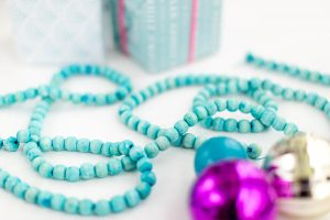 DIY Dyed Wooden Bead Christmas Garland | dreamgreendiy.com + @orientaltrading