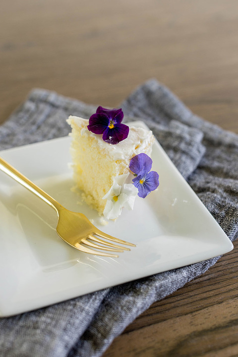 Find out how to turn a clearance grocery store cake into a Pinterest-worthy naked cake with edible flowers.