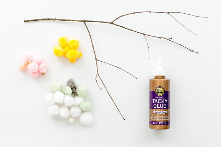 DIY Spring-Inspired Pom Pom Petaled Branches | dreamgreendiy.com + @orientaltrading